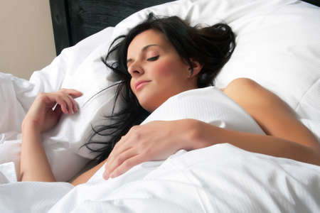 Attractive young woman is sleeping in her bed  Stock Photo