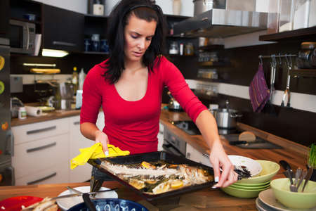Young woman do the cleaning in kitchen