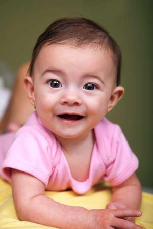 Beautiful brown-eye girl on green background Stock Photo - 12684405
