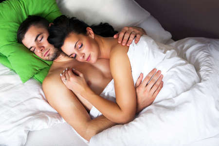 two couples: Young romantic couple sleeping in a bed