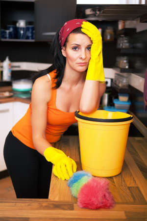 Portrait of attractive overworked  woman in kitchen Stock Photo