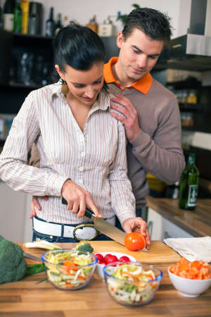 Young couple preparing vegetable lunch in kitchen  photo