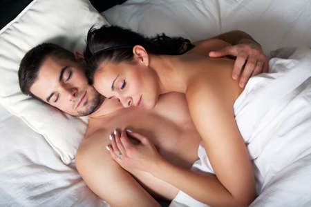 Young romantic couple sleeping in a white bed  Stock Photo
