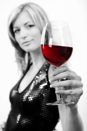 Attractive young woman with glass of red wine photo