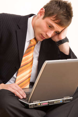 distressful: Unhappy young businessman glare to computer