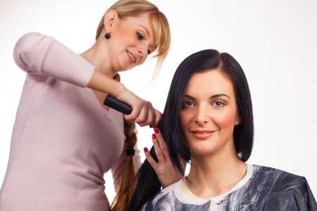 hair dresser: Hairdresser working with a client - white background