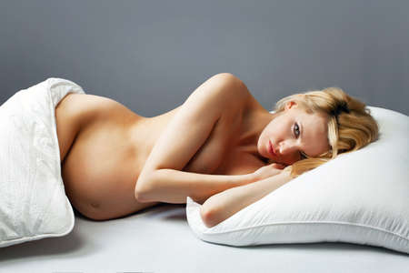 Beautiful pregnant woman in bed  photo