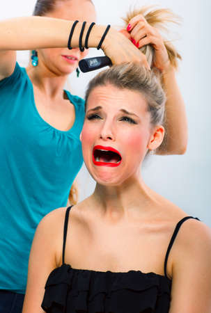 unsatisfied: Frightened woman unsatisfied with her hairdresser