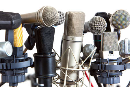 Several kind of conference meeting microphones on white background  photo