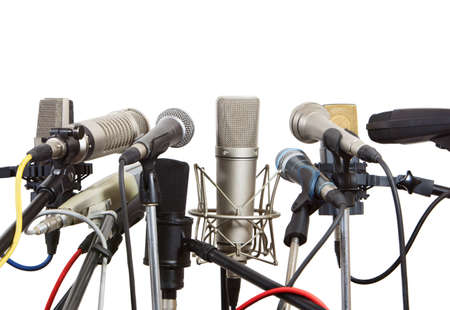 Microphones prepared for conference meeting - isolated on white  photo