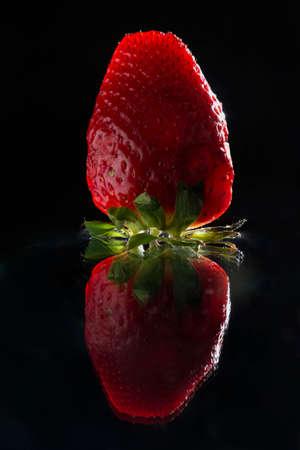 Strawberry on black background.