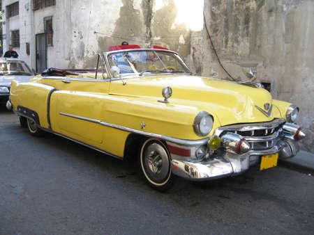 An old cabrio 1950 yellow car in Havana - Cuba Stock Photo - 10339752
