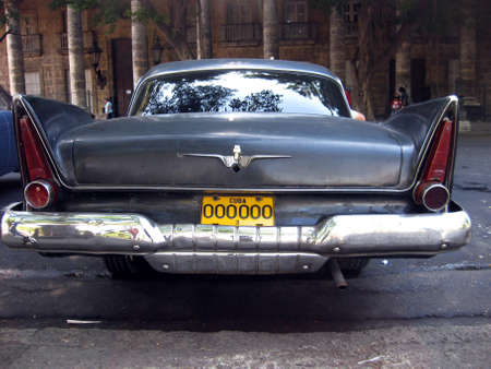 american revolution: Backside view of an old black nice Cuban car