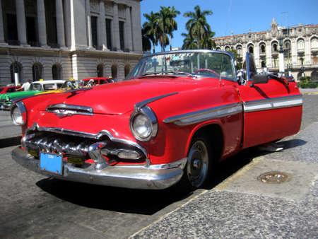 cuban culture: Red old cabrio car in Havana Cuba Editorial