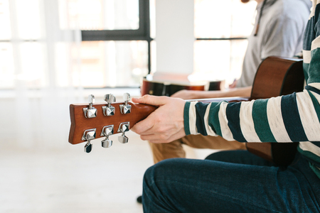 Learning to play the guitar. Music education. Reklamní fotografie