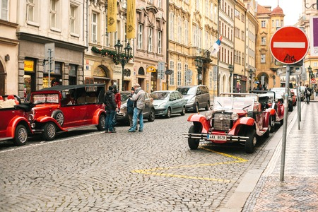 chrome man: Prague, Czech Republic, December 24, 2016: Retro cars for entertainment tourists during the Christmas holidays in Prague. Christmas time in Europe.