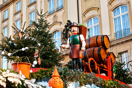 striezelmarkt: Dresden, Germany, December 19, 2016: Celebrating Christmas in Europe. Traditional decorations of roofs of shops on the Christmas market in Dresden. Toys. Editorial