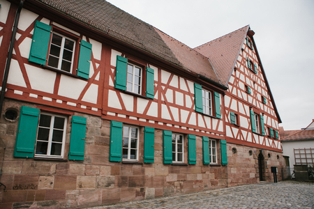 bayern old town: Traditional house in the German style in Bavaria. The architecture of houses in Germany. Stock Photo