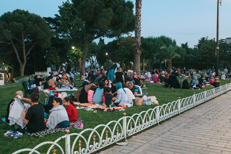 Istanbul, June 16, 2017: Many people of the Islamic religion take food on the Sultanahmet square next to the blue mosque along with their relatives at the time allowed in the Ramadan fast. Ramazan.