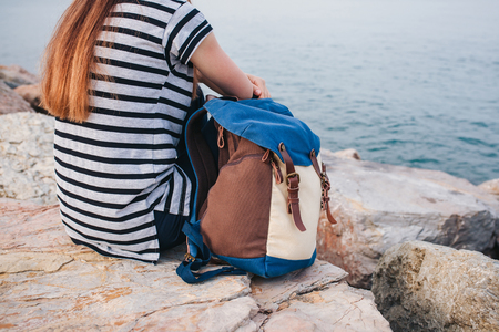 istanbul beach: Girl traveler with a backpack next to the sea. Travel, leisure, hiking.