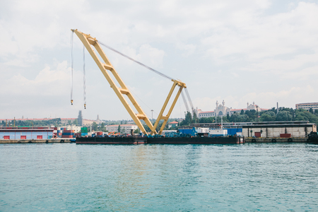 Industrial dock with loading and unloading of sea transport on the Bosporus in Istanbul, Turkey. Transportation, storage, business.