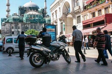 lawman: Istanbul, June 15, 2017: Two Fatih district police officers on duty and random curious passerby are wondering what is going on