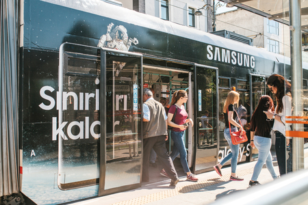 Istanbul, June 15, 2017: People get out of the subway car door and go to a nearby Samsung store and on their own business. Everyday business. Routine.