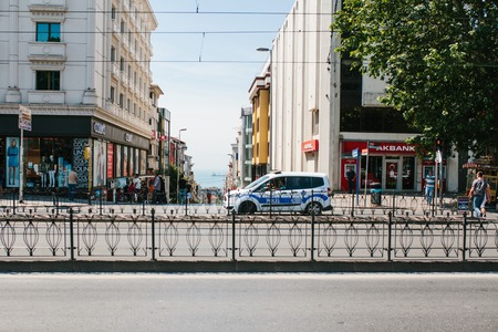 polis: Istanbul, July 11, 2017: A police car on the street in the Aksaray area in Istanbul, Turkey. Protection of public order, representatives of power, protection of the population from crime. Authorities. Editorial