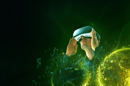 A person in virtual glasses flies to pixels. The man with glasses of virtual reality. Future technology concept. Modern imaging technology.