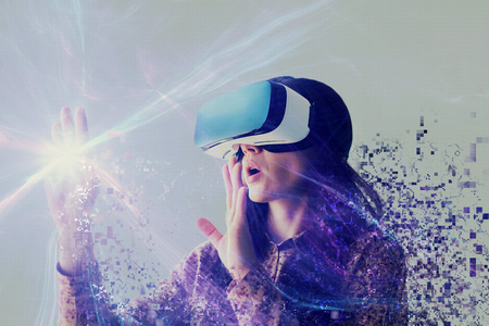 A person in virtual glasses flies to pixels. The woman with glasses of virtual reality. Future technology concept. Modern imaging technology. Stockfoto