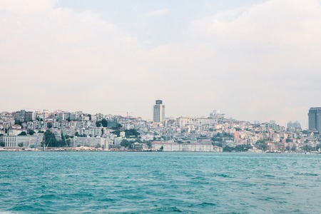 Beautiful view of the European part of Istanbul against the beautiful blue Bosphorus and sky. The modern Istanbul. Travel around Turkey.