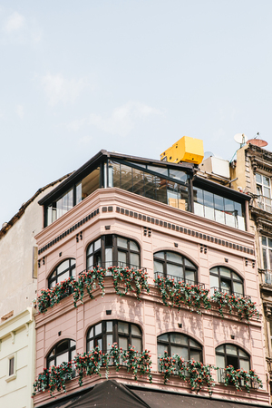 balcony: View of modern city building facade with floral balconies. Stock Photo