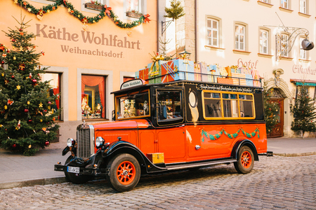 Germany, Rothenburg ob der Tauber, December 30, 2017: Decorated in a Christmas style car next to a toy store. Kathe Wohlfahrt Christmas decorations and toy shop. A popular toy store in Germany. Editöryel