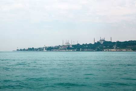 A beautiful view of the Blue Mosque is also called Sultanahmet and the Aya Sofia Museum in the European part of Istanbul. View from the Bosphorus. Turkey.
