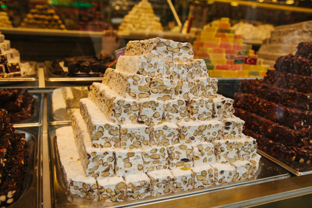 Image of turkish delight or rahat lokum pyramids on display in confectionery shop in Istanbul, Turkey. Stock Photo - 85201146
