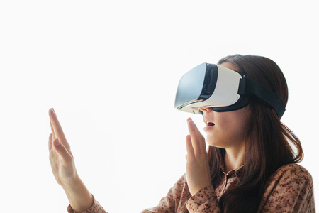 Young woman with virtual reality glasses. Modern technologies. The concept of future technology.