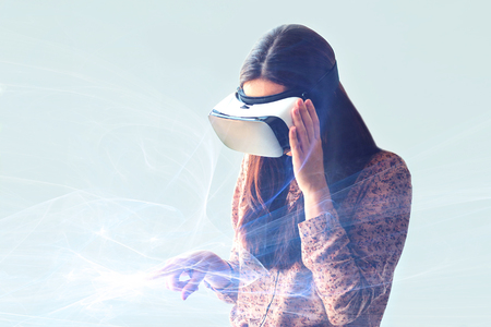 supposed: Young woman with virtual reality glasses. Modern technologies. The concept of future technology.