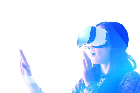 supposed: Young woman with virtual reality glasses. The concept of future technology. Stock Photo