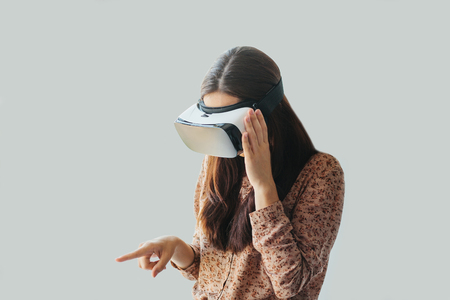 Young woman with virtual reality glasses. The concept of future technology. Stock Photo