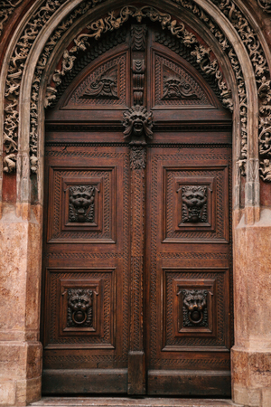 tradition: Beautiful antique door next to the Astronomical Clock on the main square in Prague in the Czech Republic.