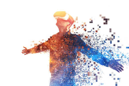 A person in virtual glasses flies to pixels. The man with glasses of virtual reality. Future technology concept. Modern imaging technology. Fragmented by pixels. Imagens