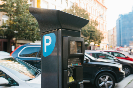 Machine for paying parking. Close-up - machine for paying parking on background of blurry cars