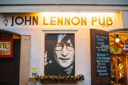 Prague, December 14, 2016: Sights of Prague. John Lennons pub with portrait of musician and menu with Christmas decorations