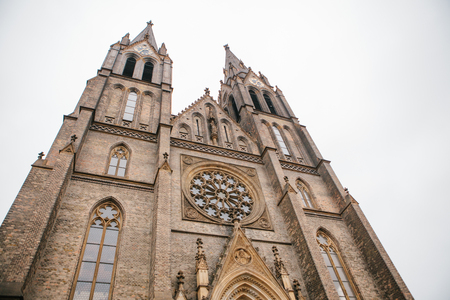Beautiful old Gothic cathedral with clock - sightseeing of Prague