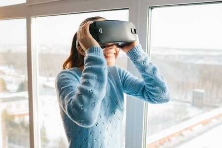 A person in virtual glasses flies to pixels. The woman with glasses of virtual reality. Future technology concept. Modern imaging technology. Fragmented by pixels. Stock Photo