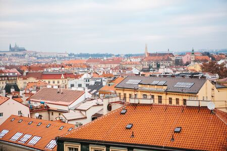 View from a high point. A beautiful view from above on the streets and roofs of houses in Prague. Traditional ancient urban architecture.