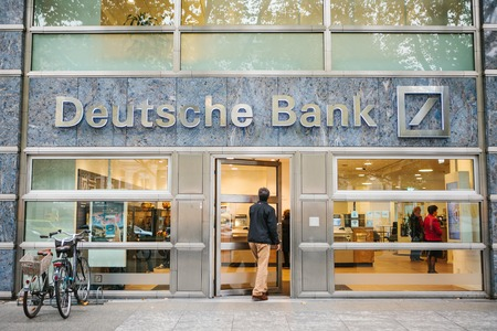 Berlin, October 2, 2017: Unknown man walks into the beautiful glass office of Deutsche Bank