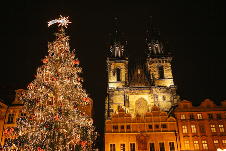 decorated christmas tree stands on the main square in prague during the new year holidays stock