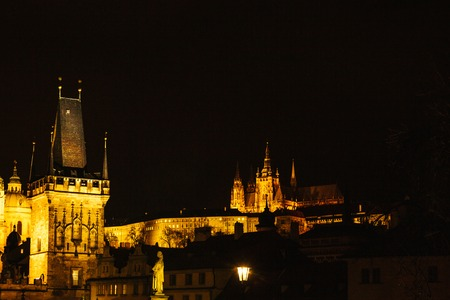 astonishing: View of the Tower of Charles Bridge. Night Christmas Decoration of Pragues main square. Street, open area. Christmas in Europe. New Year holidays.