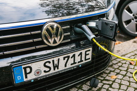 Berlin, October 2, 2017: A modern electric car is being charged at a special place for charging electric vehicles. Eco-friendly mode of transport has become widespread in Europe.